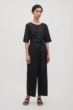 COS image 1 of Short-sleeve poplin jumpsuit in Black