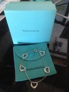 New Tiffany & Co. Elsa Peretti 5 Open Hearts Bracelet in Sterling Silver. Get the lowest price on New Tiffany & Co. Elsa Peretti 5 Open Hearts Bracelet in Sterling Silver and other fabulous designer clothing and accessories! Shop Tradesy now