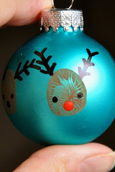 thumbprint reindeer ornament--- adorable!! from the blog little bit funky