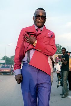 A Kinshasa Sapeur showing of his suspenders. Photo by Jackie Nickerson.