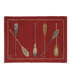 Our Hooked Wool Crimson Paddles Accent Rug will give your home a taste of back-country, log cabin style. The handsome rug features six different canoe paddles arranged on a crimson background. Designed by Vermont artist Laura Megroz, our Wool Paddles Rug is perfect for protecting and decorating your floors, hearth or door step. All-natural, luxurious New Zealand wool is hand-hooked into a thick, chunky loop that provides comfort underfoot and substantial protection for your floors or i