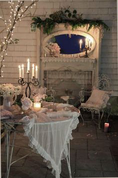 Romantic Shabby & Vintage... Love the branches.  I like the idea of framing the fireplace, wood slats behind the mirror, and upper mantel.