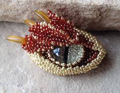 Gold Dragon Eye Pendant Two Inches Wide by mommysmoon on Etsy
