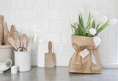 A Gift of Flowers | Give fresh flowers in a kraft paper bag tied with twine.