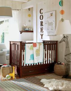 Why This Room Works  Muted primary colors combine with espresso and cream to create a tranquil palette for this nursery. Safari animals in chunky shapes with soft edges have just the right amount of charm, with mobiles of colorful spheres overhead adding a magical atmosphere and giving the baby something interesting to gaze at. A drawer built in beneath the crib is a smart, discreet storage space.