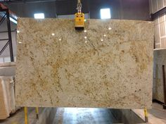 Colonial Gold has a beige/cream background with movement in browns and ambers. This granite gives the overall appearance of being light and adds a calm, neutral feel to a space. Kitchen Redo, Kitchen And Bath, New Kitchen, Kitchen Remodel, Cherry Kitchen, Kitchen Ideas, Granite Slab, Granite Kitchen, Kitchen Countertops