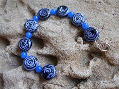 Handmade blue ceramic roses and sapphire bracelet by KANDYLEES