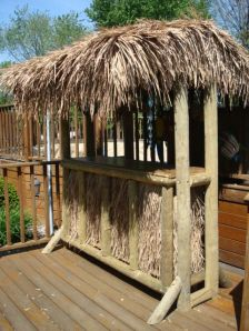 Tiki bar!--I believe my hubby could build this for by the pool!!