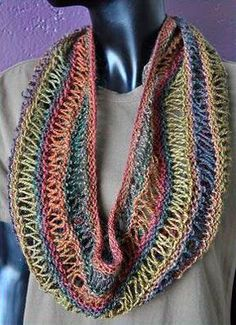Sausaltio Drop Stitch Cowl  Description: This super easy cowl is beautiful, light and airy.  It uses dropped yo stitches to create bands of simple lace.  It is worked back and   forth, then the ends are sewn together to create the cowl.