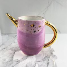 Lilac Unicorn Mug - Cute Handmade Unicorn Ceramic Mug! I threw this mug on the wheel, attached a spiral unicorn horn and handle, and then lovingly hand painted the entire piece. Accented it in gold. Unicorn Gifts, Unicorn Party, Coffee Cups, Tea Cups, Unicorns And Mermaids, Party Decoration, Cool Mugs, All I Ever Wanted, Mug Cup