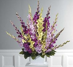 purple and green gladiolas: too many, but pretty color combo