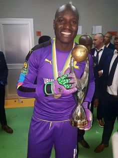 ONYANGO Is First Ugandan To Win CAF Champions League - Uganda Cranes goalie Denis Masinde Onyango has gone into history books as the first Ugandan