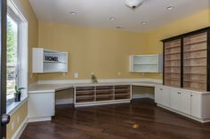 Craft room with tons of built ins.