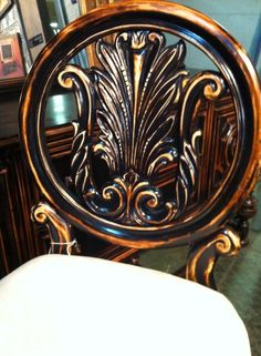 Black distressed chair  For more, follow us on Facebook