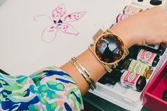 Ashley Begley, Associate Designer for Print and Pattern @lillypulitzer wears a vintage snake bracelet, and a Lilly Pulitzer tortoise cuff.