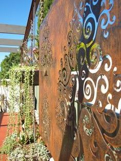 Corten steel garden screen - absolutely gorgeous