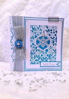 Angela O'Donoghue - A6 Create a Card Decorative Bauble die - Snowflake Edge'able die - Let it snow stamp - Centura pearl/silver card - Blue miri card - Silver ribbon - Blue button - Clear gems - #crafterscompanion #Christmas