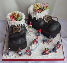 Santa Boots and Penguin Party Boozy Fruit Cakes.  Donated to Hobbs the Printers, to raise money for the Rose Road Charity in Southampton.