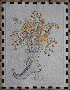 A different Halloween quilt, embroidered by Renee, and quilted by Jan Hutchison. From her website: The Secret Life of Mrs. Meatloaf. Go to website to see the full quilt.