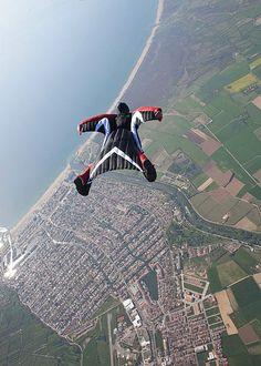 Wingsuit flying over Empuriabrava, Spain. Photo © www.visualphotos.com