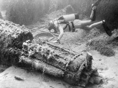 A diver in Malta inspects a wartime Spitfire, found 32 feet under water at the bottom of Marsalform Bay, The plane was recovered and taken to Malta.