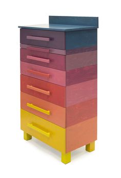 Dresser with six drawers and one extendable shelf, painted with nine semitransparant colours. From yellow, via orange and red to purple and then a little jump to blue. The drawers and the extendable shelf are fitted with tray guides and can be fully pulle…
