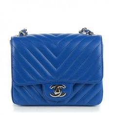 This is an authentic CHANEL Caviar Chevron Quilted Mini Square Flap in Blue. The chic little cross body features caviar leather with sophisticated chevron quilting in bright blue.