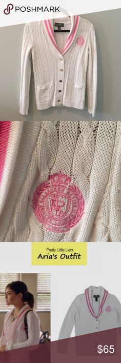 "Shawl Collar Cabel Sweater by Ralph Lauren Pretty Little Liars fans might recognize this Lauren by Ralph Lauren Active Golf Shawl-Collar Cabled Cardigan worn by Aria Montgomery in season 4.  All over cable-knit body. Shawl collar with duel stripes at edges. Button placket with silver-toned buttons. Ribbed cuffs & hem. Welt pockets at hips. Embroidered ""LRL"" crest accents. Excellent condition Ralph Lauren Sweaters Cardigans"