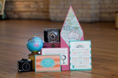 summer travel wedding party inspiration, traveling, luggage, globes, cupcakes, macarons, colorful wedding party session, roses, vintage, stamps, bicycle, mismatched china, airplanes