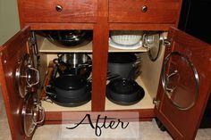 Kitchen cabinet organization - command hooks on door for lids