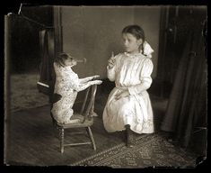 A girl playing with a dog, c1913 by crackdog, via Flickr