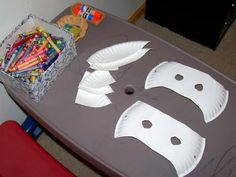 decorate a paper plate with stickers and crayons and then make a mask out of it