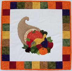 Thanksgiving quilt pattern.  Bountiful Cornucopia Quilt Pattern NQD-030 (, wall hanging)- $10.50 Check out our Christmas quilt patterns. https://www.pinterest.com/quiltwomancom/christmas/  Subscribe to our mailing list for updates on new patterns and sales! http://visitor.constantcontact.com/manage/optin?v=001nInsvTYVCuDEFMt6NnF5AZm5OdNtzij2ua4k-qgFIzX6B22GyGeBWSrTG2Of_W0RDlB-QaVpNqTrhbz9y39jbLrD2dlEPkoHf_P3E6E5nBNVQNAEUs-xVA%3D%3D