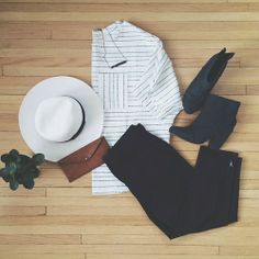 Black and white striped shirt with contrasting pocket, black jeans and ankle boots