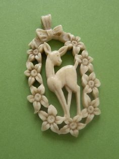 Pretty little vintage fawn pendant - possibly celluloid.