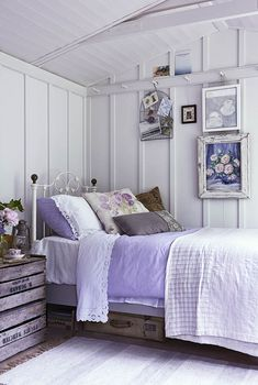 small bedroom with hints of lilac and hanging rail