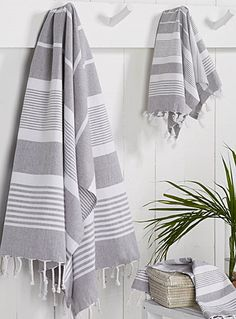 Exclusively from Simons Maison The fouta, originating from Tunisia, is known for its woven stripes, rolled fringes and beautiful artisanal look.
