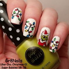 Grinch nail art using Uber Chic and Sugar Bubbles stamping plates.