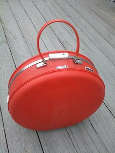 Red Round Circle Suitcase Traincase - American Tourister Tiara Vintage Luggage - Hat Box. $125.00 USD, via Etsy.