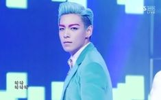 T.O.P. had gone to a new level of awesomeness with his blue hair and hot pink eyebrows!
