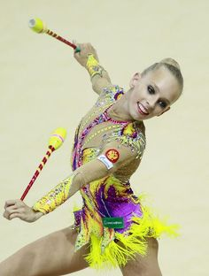 650xYana Kudryavtseva of Russia performs with the clubs