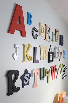 Alphabet wall how to...have always wanted to do this. Cool idea to have everyone bring a letter to your baby shower.