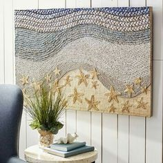"""Pier 1 - Drawing inspiration from the ocean floor, our Sandy Beach Wall Panel is a natural beauty. Indonesian artists craft the mixed media piece of wood and water hyacinth that's woven, layered and painted in washes of sand, aqua and blue. Hang it on a sizable wall, and it's sure to make waves. -  Multicolor, 47.25""""W x 1.37""""D x 31.50""""H, Engineered wood, cardboard, polyester, water hyacinth, seagrass, mendong, raffia, metallic thread, Imported"""