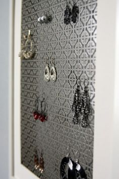 Ikea frame and mat + decorative radiator  cover sheet from Home Depot = earring storage.
