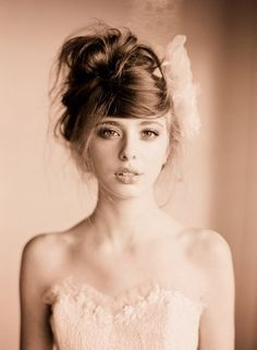 this is a bridal hairdo in the picture but I think it would be cute for everyday
