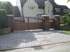 Automatic Entrance Gates and pedestrian side gate with brick piers. Designed by Sue Davis of outside-rooms.co.uk