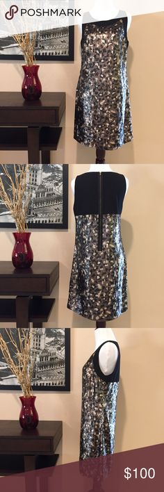 Trina Turk Black & Brown Sequin Cocktail Dress Trina Turk Black & Brown Sequin Cocktail Dress. Worn once - in perfect condition. Very cute and flattering. Exposed back zipper, sort of cammo print sequins - black, brown/bronze, and tan. No missing sequins. Tank style/sleeveless dress. Amazing quality, fully lined, size 4. 100% polyester. Trina Turk Dresses