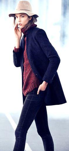 LESBIAN (ideal look) -- blue jeans, large sweater, short overcoat, interesting felt hat. (again w/ men's loafers)