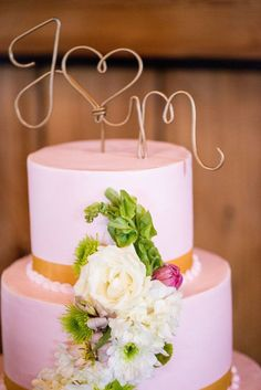 """""""We made our cake topper, which was wire bent into our initials and painted gold"""" Spring Barn Wedding - Bethaney Photography. Click http://www.confettidaydreams.com/romantic-spring-barn-wedding/"""