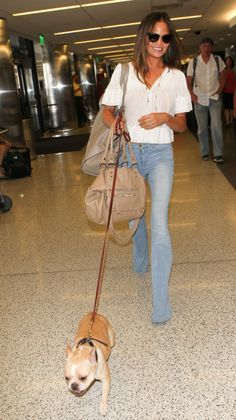 Chrissy Teigen channels the '70s at LAX with an adorable pup leading the way.                                     via @AOL_Lifestyle Read more: http://www.aol.com/article/2015/06/22/travel-fashionably-the-best-celebrity-airport-style-inspiration/20948634/?a_dgi=aolshare_pinterest#slide=2854334|fullscreen